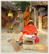 Woman making handmade cards at home, Bangladesh.